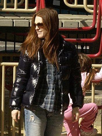 Juliane Moore in black Moncler down jacket