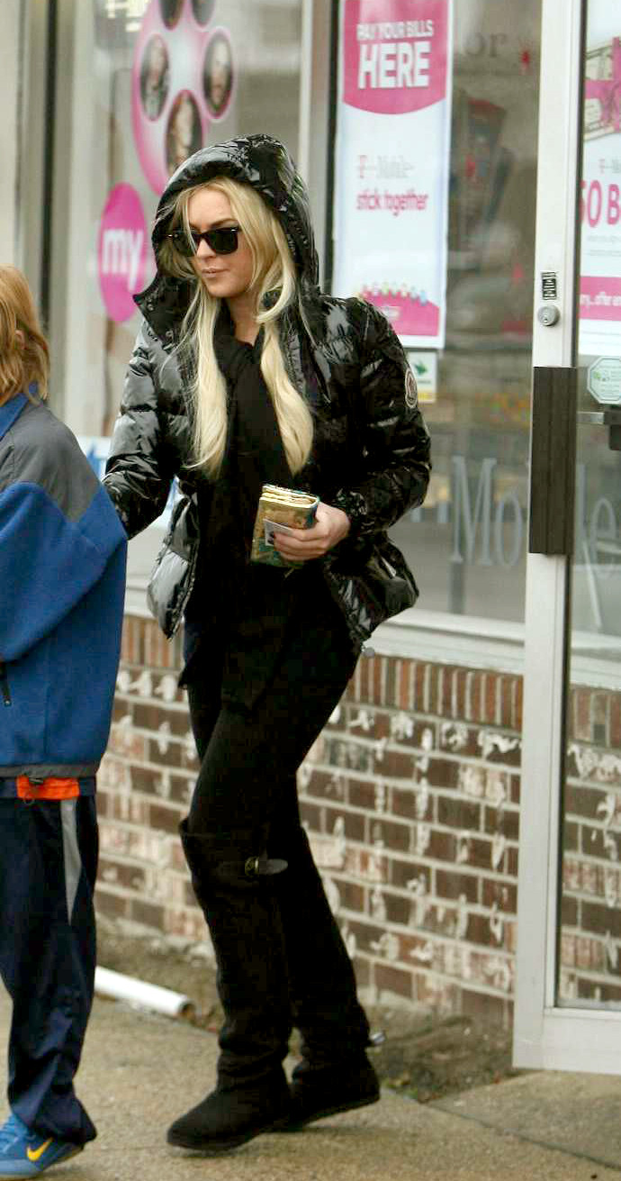 "e809c5bea Lindsay Lohan in black hooded Moncler ""Badia Vernis"" down jacket ..."