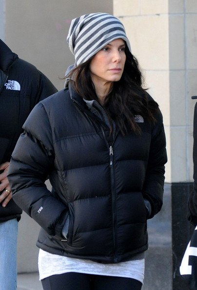 "a4d29ad7c Sandra Bullock in black The North Face ""Nuptse"" down jacket 