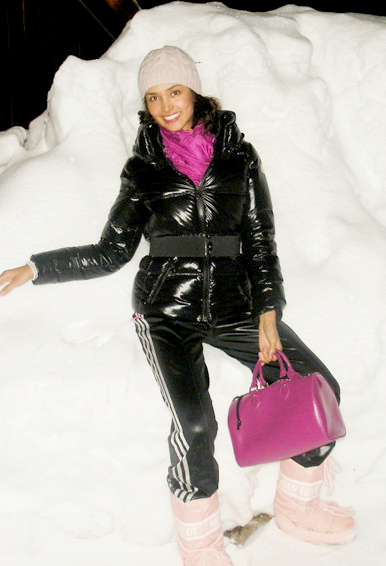 Black Moncler down jacket, black adidas rain pants and pink Moon ...